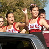 Members of the Chadron State College cheerleading squad wave during the homecoming parade Saturday, Oct. 1. (Photo by Justin Haag)