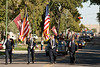 The Chadron Veterans Honor Guard leads the Chadron State College homecoming parade Saturday, Oct. 1. As a change from years past, the parade traveled from north to south. (Photo by Justin Haag)