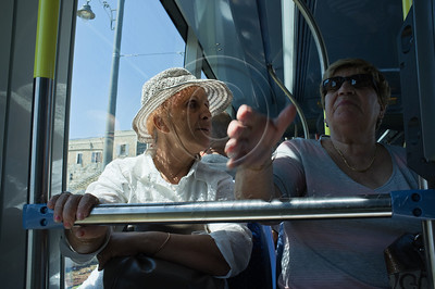 Two female passengers discuss the air-conditioning on the new tram offering passengers free rides since August 19th until the end of this week. Jerusalem, Israel. 28/08/2011.