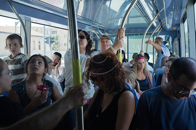 Passengers crowd the tram cars as rides are free until the end of this week and for many it's nothing more than an exciting, free, summer-vacation activity. Jerusalem, Israel. 28/08/2011.