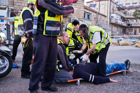 Orthodox Jewish ZAKA volunteers administer Cardio Pulmonary Resuscitation in a training session. Jerusalem, Israel. 1st January 2012.