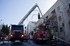 Lead by recently appointed Chief of Jerusalem Fire Brigade Shmulik Friedman, firefighters extinguish a basement apartment fire. Five injured lightly. Five others trapped on top floors evacuated by crane. Jerusalem, Israel. 9th January 2012.