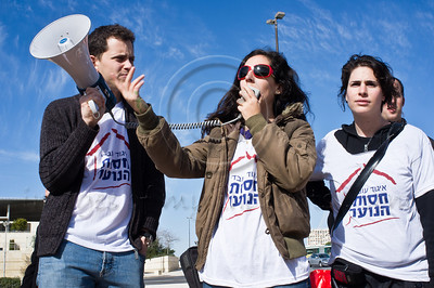 """Youth Protection Services workers march to Ministry of Social Affairs demanding ministry fulfills promise of budget increase of 30 million NIS. Demonstration motto is """"breadcrumbs are for birds"""". Jerusalem, Israel. 10th January 2012."""