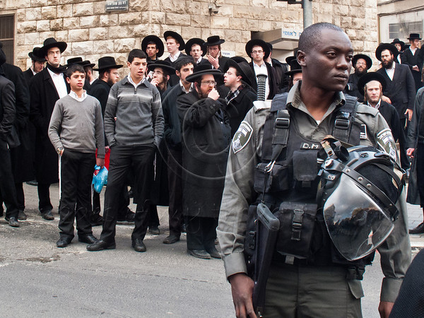 Police break up rioting by hundreds of Haredim in the neighborhood of Mea Shearim near Kikar Hashabbat following the arrest of six community members this morning for alleged tax offenses worth millions. Jerusalem, Israel. 15th January 2012.