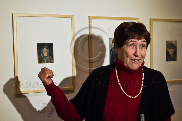 Ms. Nira Gold finds it difficult to hide her excitement as she points to portraits of her grandmother, Dvora Milka Semmel, and grandfather, Baruch Semmel, created by artist Arnold Dagahni in 1943. Jerusalem, Israel. 23rd January 2012.