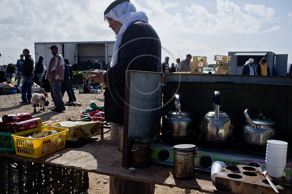 A man stands by his kiosk offering tea and coffee as Bedouins congregate for Bedouin Market Day continuing a long tradition that has positioned Beersheba as the central place of commerce for the Negev Desert. Beersheba, Israel. 26th January 2012.