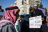 "Protestor carries sign reading ""KKL-JNF in planting trees and uprooting people"" as Bedouins of Al-Arakib protest against KKL and its intention to forcefully evict them from, what they call, their own land. Jerusalem, Israel. 29th January 2012."