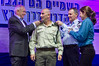 Minister of Internal Security Yitzhak Aharonovitch (L), Police Commissioner Yohanan Danino (R) and wife award rank of Chief Superintendent to Eliyahu Shmul at ceremony at Police National Headquarters. Jerusalem, Israel. 30th January 2012.