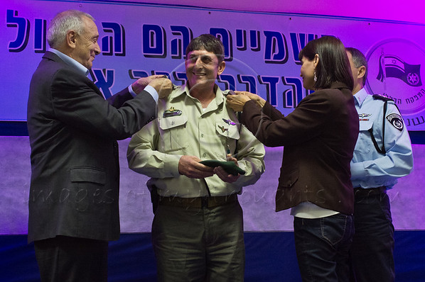Minister of Internal Security, Yitzhak Aharonovitch (L), Police Commissioner, Yohanan Danino (R) and wife award the rank of Brigadier General to Uzi Levy, Border Police Commander of Northern District. Jerusalem, Israel. 30th January 2012.