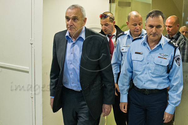 Minister of Internal Security, Yitzhak Aharonovitch (L), and Police Commissioner, Yohanan Danino (R), enter police headquarters mess hall to take part in a festive ceremony awarding ranks to senior officers. Jerusalem, Israel. 30th January 2012.