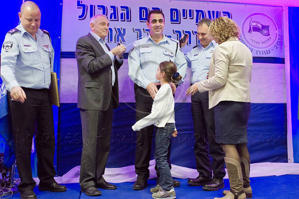 Minister of Internal Security Yitzhak Aharonovitch (L), Police Commissioner Yohanan Danino (R) and wife award rank of Brigadier General to Simeon Lavi, Commander of the Operations Division, Tel-Aviv District. Jerusalem, Israel. 30th January 2012.