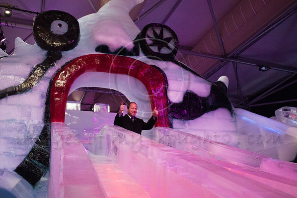 Jerusalem Mayor Nir Barkat displays the 'thumbs up' all is well sign as he slides down the ice on the famous 'Monster' slide carved of ice at Jerusalem's first International Ice Festival set to open March 6th. Jerusalem, Israel. 28-Feb-2012.