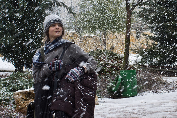 A young woman makes her way in a snowstorm after many years without snow in Jerusalem. Heavy snowfall continues this morning disrupting schools and public transportation. Jerusalem, Israel. 02-Mar-2012.