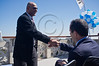 Jerusalem Mayor Nir Barkat (R) shakes hands with Itzchak Lari (L), Deputy GM of Toto Winner, a major marathon sponsor, at a press conference on the rooftop of Notre Dame Hotel regarding the upcoming second Jerusalem International Marathon. Jerusalem, Israel. 6-Mar-2012.