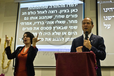 Mayor Nir Barkat addresses the audience in a special Purim reading of the Book of Esther for the deaf and hearing-impaired at Bet Zusman using special amplifiers, visual projection and simultaneous sign language translation. Jerusalem, Israel. 8-Mar-2012.