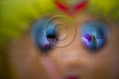 Purim celebrators are viewed through the eyes of a mask as they assemble at Bet-Zusman for a special Purim reading of the Book of Esther for the deaf and hearing-impaired with special amplifiers, visual projection sign language translation. Jerusalem, Israel. 8-Mar-2012.