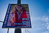 A poster of Dorit, a poet, is displayed in the French Hill on International Women's Day defying a citywide wave of gender segregation in the public sphere imposed by religious pressure. Jerusalem, Israel. 8-Mar-2012.