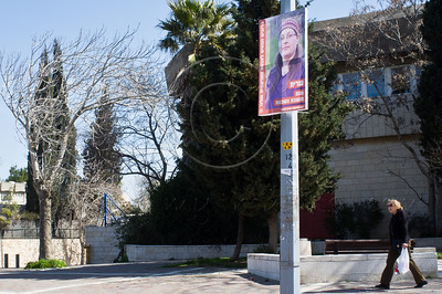 A poster of Sarit, a kindergarten teacher, is displayed in the French Hill on International Women's Day defying a citywide wave of gender segregation in the public sphere imposed by religious pressure. Jerusalem, Israel. 8-Mar-2012.