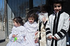 Ultra-Orthodox religious children wearing costumes mimick the wardrobe of elders in their community on the holiday of Purim. Purim is celebrated as a happy, carnival-like holiday. Jerusalem, Israel. 8-Mar-2012.