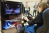 A young girl tests her driving skills on a Playstation console at the Jerusalem Marathon Expo that opened today for three days leading up to the marathon this Friday (March 16th). Jerusalem, Israel. 13-Mar-2012.