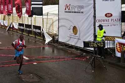 Alex Chepwik Saekwo crosses the finish line of the 21Km Half Marathon in third place. Saekwo's official time was 01:06:41. Jerusalem, Israel. 16-Mar-2012.