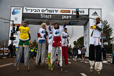 Clowns on stilts entertain the crowds and cheer the runners in the Second Jerusalem International Winner Marathon with the participation of over 15,000 runners in a variety of races. Jerusalem, Israel. 16-Mar-2012.
