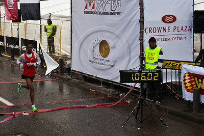 Feyisa Lema crosses the finish line of the 21Km Half Marathon in second place. Lema's official time was 01:06:03. Jerusalem, Israel. 16-Mar-2012.