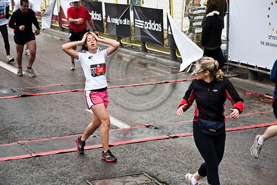 A young woman struggles for her breath on the finish line of the 21Km Half Marathon. Jerusalem, Israel. 16-Mar-2012.