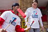 Basketball players of the Hapoel Jerusalem club volunteer to paint old residential buildings on Stern Street in Kiryat Yovel on 'Good Deeds Day'. Jerusalem, Israel. 20-Mar-2012.