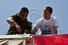 Mayor Nir Barkat assists a volunteer IDF soldier in painting during a visit to one of 48 projects carried out in the city on 'Good Deeds Day' as the Municipality participates in a national project that encourages work for the community. Jerusalem, Israel. 20-Mar-2012.