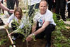 Mayor Nir Barkat and businesswoman and philanthropist Shari Arison plant a tree in a community garden on Stern Street in Kiryat Yovel on 'Good Deeds Day'. Jerusalem, Israel. 20-Mar-2012.