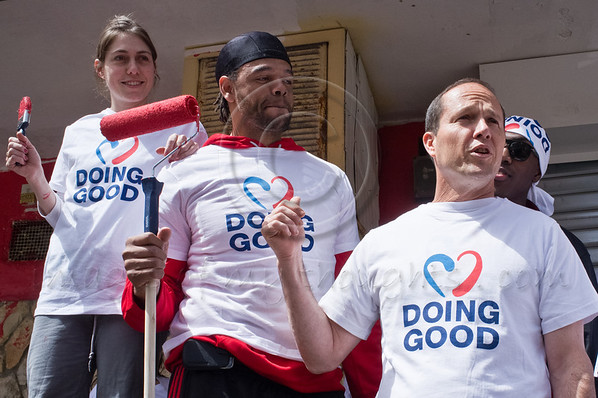 Mayor Nir Barkat  poses for photos with volunteer community workers including basketball players of Hapoel Jerusalem club on 'Good Deeds Day'. Jerusalem, Israel. 20-Mar-2012.