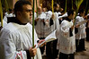 Priests carry palm branches in a Palm Sunday procession  at The Church of the Holy Sepulchre celebrating Jesus' triumphant entry into Jerusalem.  Jerusalem, Israel. 1-Apr-2012.