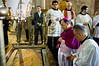 Latin Patriarch of Jerusalem, Archbishop Fouad Twal, kneels before the Stone of Unction at the Church of The Holy Sepulchre on Palm Sunday celebrating Jesus' triumphant entry into Jerusalem.  Jerusalem, Israel. 1-Apr-2012.