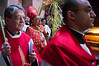 Latin Patriarch of Jerusalem, Archbishop Fouad Twal (C), joins priests carrying palm branches in a Palm Sunday procession  at The Church of the Holy Sepulchre.  Jerusalem, Israel. 1-Apr-2012.