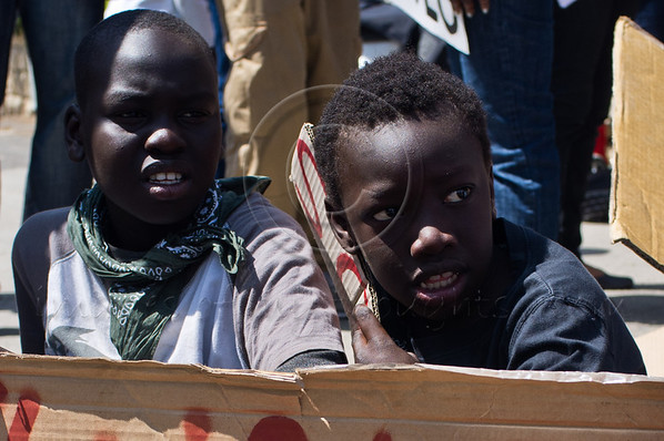 A group of South Sudanese refugees protests opposite the Prime Minister's Residence as collective protection from deportation for South Sudanese expires today. Jerusalem District Court has issued an injunction forbidding deportation before April 15th. Jerusalem, Israel. 1-Apr-2012.