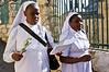 Two nuns descend from the Mount of Olives in Palm Sunday procession in celebration of Jesus' triumphant entry into Jerusalem. Jerusalem, Israel. 1-Apr-2012.