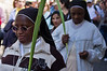 Two nuns descend from the Mount of Olives in Palm Sunday procession carrying palm branches in celebration of Jesus' triumphant entry into Jerusalem. Jerusalem, Israel. 1-Apr-2012.