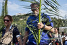 Thousands take part in Palm Sunday procession ascending from Gethsemane to the Lions' Gate, carrying palm branches, singing 'Hosanna to the Son of David' and accompanied by musical instruments. Jerusalem, Israel. 1-Apr-2012.