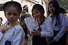 Thousands take part in Palm Sunday procession which begins at Bethphage Church, on the eastern slopes of the Mount of Olives, ascends to the summit and then descends to Gethsemane. It then proceeds through the Lions' Gate to the Church of St. Anne. Jerusalem, Israel. 1-Apr-2012.