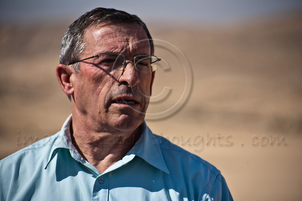 Retired Brigadier General, Deputy GM of Ministry of Defense, Bezalel Traiber, surveys area designated for 'Training Base City' and groundwork progress in advance of construction to begin in coming weeks and be completed in 2014. Negev, Israel. 3-Apr-2012.