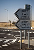 Road sign indicates access via Road 224 to area designated for 'Training Base City'. Negev, Israel. 3-Apr-2012.