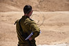 "An IDF officer stares into the desert near the new ""Hour Glass"" Israel-Egypt security fence. Negev, Israel. 3-Apr-2012."