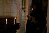 A nun prays next to candles at the Church of the Holy Sepulchre on Holy Thursday. Jerusalem, Israel. 5-Apr-2012.