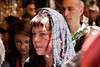 Thousands of Christian pilgrims retrace the last steps of Jesus through the Via Dolorosa to the Church of the Holy Sepulchre on Good Friday, singing and chanting in a mix of languages, costumes and traditions. Jerusalem, Israel. 6-Apr-2012.