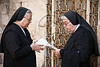 Two nuns in prayer near the Holy Sepulchre Church. Jerusalem, Israel. 6-Apr-2012.