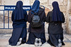 Three nuns kneel in prayer near the Holy Sepulchre Church. Jerusalem, Israel. 6-Apr-2012.