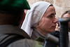 A nun walks past a border policeman securing proceedings at the Holy Sepulchre Church. Jerusalem, Israel. 6-Apr-2012.
