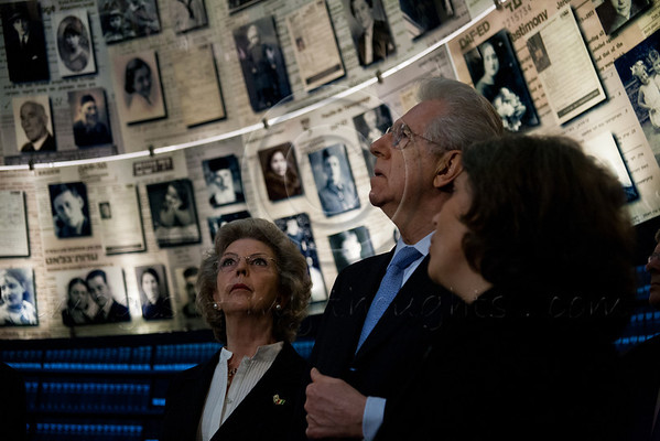 Italian Prime Minister, Mario Monti, and wife, Antonioli Monti, receive instruction from Dr. Yael Nidam Orvietto as they gaze up at enlarged Pages of Testimony displayed on the ceiling of the Hall of Names at Yad Vashem. Jerusalem, Israel. 9-Apr-2012.