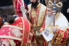 A procession of priests leading Theophilus III (R), Patriarch of Jerusalem, arrives at the courtyard of the Church of the Holy Sepulchre as thousands assemble for the traditional Washing of the Feet ceremony led by Theophilus III, Patriarch of Jerusalem. Jerusalem, Israel. 12-Apr-2012.